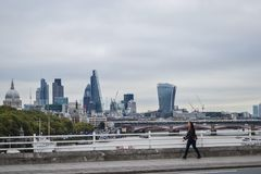 London, UK, September 26, 2014, The girl is walking down the street against the backdrop of the London City. royalty free stock images