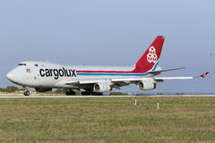 3 September 2015, Luqa, Malta: Jumbojet about to take off. Cargolux Boeing 747-4R7F/SCD departing to Muscat, Oman. It arrived from Luxembourg about 2 hours Stock Photo