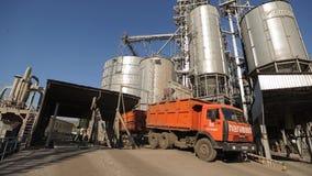 10 September, 2016, Mariupol, Ukraine, Ukrtransagro LLC. Close view of unloading grain trucks at elevator on elevating. 10 September, 2016, Mariupol, Ukraine stock video