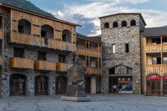 September 2014, Mestia, Georgia - Seti square with queen Tamara monument. Stone buildings and modern monument in the center of Svaneti royalty free stock photography