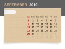 September 2019 - Monthly calendar on brown paper and wood background with area for note. Vector illustration vector illustration