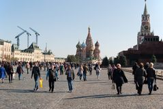 September 2917, Moscow, Russia. Red square with a rest people. A lot of people walk on red square in Sunny day output Royalty Free Stock Photo