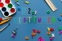 September 22nd. Day 22 of month, Back to school concept. Calendar on teacher or student workplace background with school Stock Photos