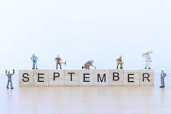 September ord med miniatyrfolkarbetaren Royaltyfri Fotografi