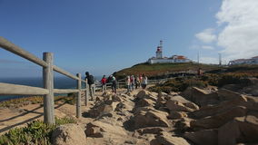 September 2015 Portugal Nice view of a lighthouse with the ocean in Portugal, torists and rocks stock footage