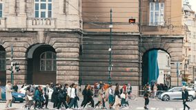 September 12, 2017 - Prague, Czech Republic: crowd of people crosses the street on a pedestrian crossing to the green stock footage