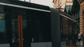 September 12, 2017 - Prague, Czech Republic: streets of the city, urban landscape, modern tram from which people leave stock video footage