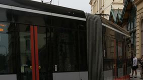 September 12, 2017 - Prague, Czech Republic: streets of the city, urban landscape, modern tram from which people leave stock video