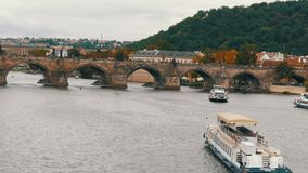 September 12, 2017 - Prague, Czech Republic: Many Tourist Boats pass on the river in Prague, Vltava with a lot of stock video footage
