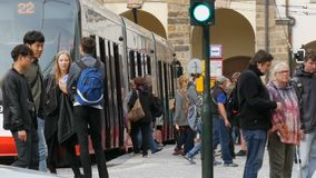 September 12, 2017 - Prague, Czech Republic: tram is at a stop in the center of Prague, people come out and enter in it stock footage