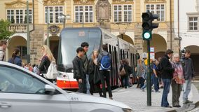 September 12, 2017 - Prague, Czech Republic: tram is at a stop in the center of Prague, people come out and enter in it stock video footage