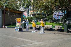 September 5, 2017 San Francisco/CA/USA - Falun Gong devotees meditating and spreading information about the movement in Portsmouth royalty free stock photos