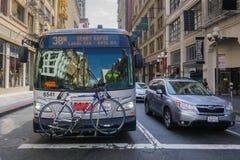 September 5, 2017 San Francisco/CA/USA - Muni bus carrying a bicycle at a traffic stop in downtown San Francisco royalty free stock image