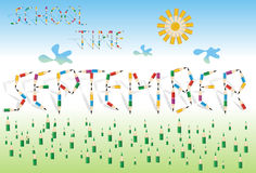 September the school month. Grass, sun and words formed from colored pencils on blue background Stock Images