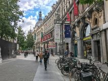 The shopping street Meir in Antwerp, Belgium. September 2017: Shoppers stroll on the Meir shopping street, Antwerp, Belgium royalty free stock images