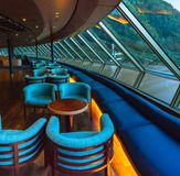 September 15, 2018 - Skagway, AK: Empty seats at dawn inside The Crow`s Nest lounge aboard The Volendam cruise ship. royalty free stock images