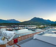 September 15, 2018 - Skagway, AK: Harbour at dawn from deck of The Volendam cruise ship. September 15, 2018 - Skagway, AK: Harbour and mountins at dawn from royalty free stock image