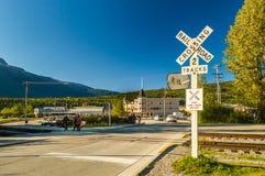 September 15, 2018 - Skagway, AK: Railway tracks crossing near Dewey Creek on Congress Way. royalty free stock photo