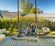 September 15, 2018 - Skagway, AK: Ton Of Goods, a bronze stampeder and staple dog sculpture. stock photos