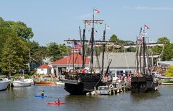 Columbus ships Nina and Pinta in South Haven harbor. September 3, 2017 South Haven MI USA;  people in kayaks float past replica Columbus ships the Nina and the Stock Images