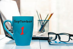 September 1st. Day 1 of month, Back to school concept. Calendar on cup morning coffee or tea teacher, student workplace Stock Photos