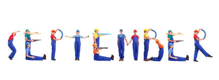 September staff. Group of young people wearing different color uniforms and hard hats forming September word - isolated on white background - calendar concept Royalty Free Stock Photo
