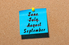 September start and summer end concept written on sticker pinned at notice board. Striked June, July, August Royalty Free Stock Images