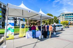 Waymo stand in downtown Sunnyvale. September 27, 2018 Sunnyvale / CA / USA - Representatives from Waymo talk to visitors at `Sunnyvale Technology Business Expo` royalty free stock photography
