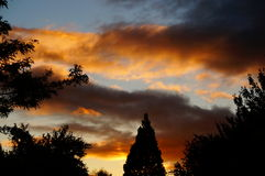September sunset. A late summer sunset displays vibrant colors in the sky Stock Photography