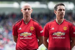 Nicky and Gary Neville line up at Pairc Ui Chaoimh pitch before the start of the Liam Miller Tribute match stock photos