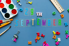 September 29th. Day 29 of month, Back to school concept. Calendar on teacher or student workplace background with school. Supplies on blue table. Autumn time Royalty Free Stock Image
