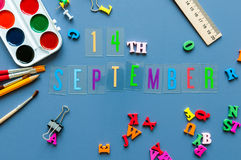 September 14th. Day 14 of month, Back to school concept. Calendar on teacher or student workplace background with school. Supplies on blue table. Autumn time Stock Images
