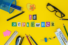 September 28th. Day 28 of month, Back to school concept. Calendar on teacher or student workplace background with school Royalty Free Stock Photography