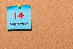 September 14th. Day 14 of month, color sticker calendar on notice board. Autumn time. Empty space for text.  Royalty Free Stock Images