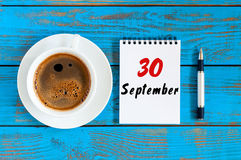 September 30th. Day 30 of month, loose-leaf calendar and hot cacao cup at translator or interpreter workplace background. Autumn time. Empty space for text Royalty Free Stock Photography