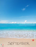 September on a tropical beach under clouds Royalty Free Stock Image
