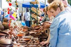 16 September 2017 Ukraine, White Church. People choose pottery at the fair stock photos