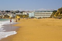 A view along Praia do Inatel in Albuferia with sun beds and sand royalty free stock photography