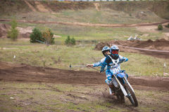 24 september 2016 - Volgsk, Russia, MX moto cross racing - two girls bike riders make selfy riding motorcycle Royalty Free Stock Photography