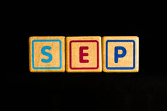 September on wood Cubic on black background Stock Photography