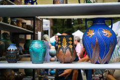 September 4, 2017 Woodside/CA/USA - Handcrafted colorful flower vases displayed at the Kings Mountain Art Fair located on Skyline. Boulevard on Labor Day, San royalty free stock images