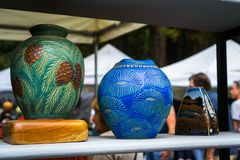 September 4, 2017 Woodside/CA/USA - Handcrafted colorful flower vases displayed at the Kings Mountain Art Fair located on Skyline. Boulevard on Labor Day, San royalty free stock photography