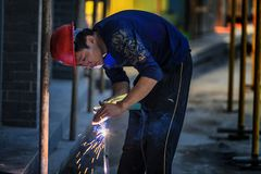 Worker obscuring arc welding by hand. In September 2017, a worker in Nanjing, China did not use a protective device that shielded the arc welding, but only royalty free stock photography