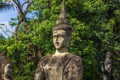26 septembre 2014 : Statue en pierre bouddhiste en parc de Bouddha, Laos Photographie stock libre de droits
