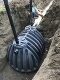 Septic leach field installation with tank. Plastic septic tank being installed Stock Image