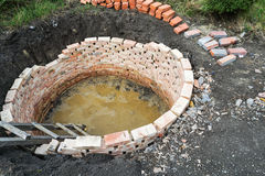 Septic tank. Round septic tank with red bricks Stock Images
