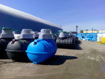 Septic tanks and other storage tanks at the manufacturer factory depot. Septic tanks and other storage tanks in rows at the manufacturer factory depot Stock Images
