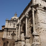 Septimius Severus Arch. (Arc Settimio Severe) in Rome (Italy) with temple behind Royalty Free Stock Photography