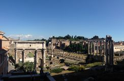 Septimius Severus Arch. And Tempio di Saturno at the Roman Forum in Rome Italy Royalty Free Stock Photos