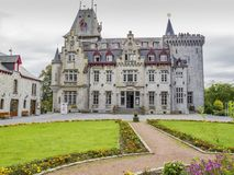 SEPTON-DURBUY, BELGIUM - SEPTEMBER 26, 2014: Castle of Petite Somme, Radhadesh against an overcast sky. SEPTON-DURBUY, BELGIUM - SEPTEMBER 26, 2014: Castle of royalty free stock photo